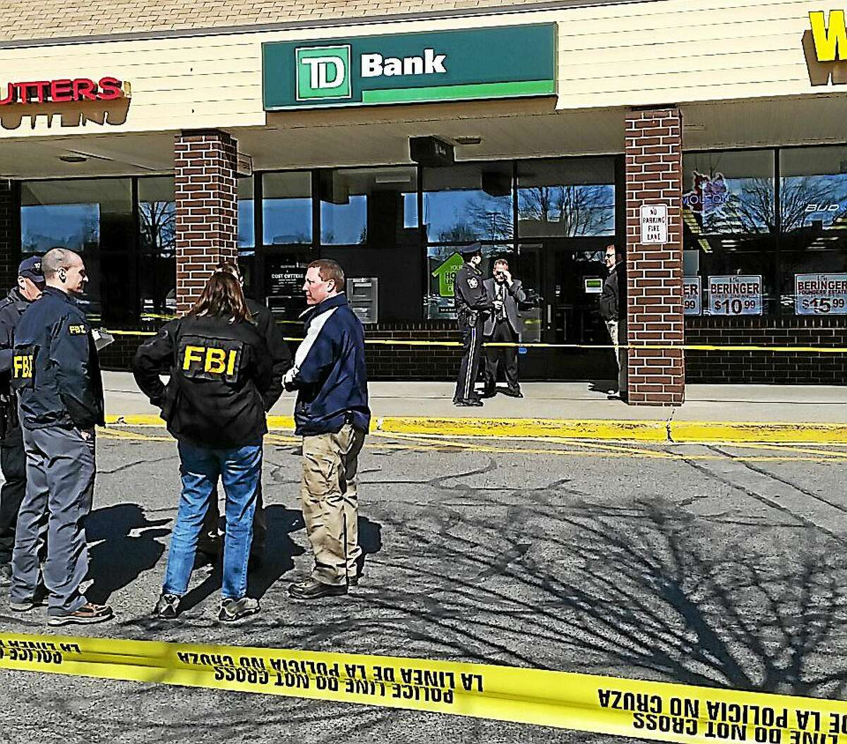 TD Bank at 215 High St. in Torrington was robbed Tuesday morning. Police say the robber was caught after crashing on Route 7 on the New Milford/Brookfield line.