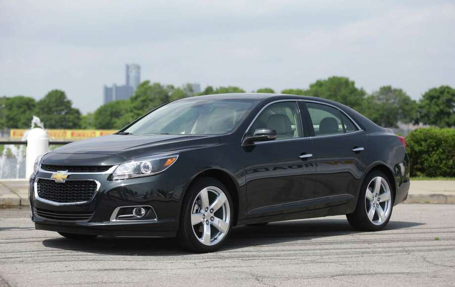 FILE - In this May 31, 2013 file photo, the 2014 Chevrolet Malibu midsize sedan is unveiled on Belle Isle in Detroit. General Motors on Tuesday, March 24, 2015 said it is recalling nearly 92,000 Malibus from the 2013 through 2015 model years to fix a problem with the power sunroof controls.(AP Photo/Carlos Osorio, File) Photo: AP / AP