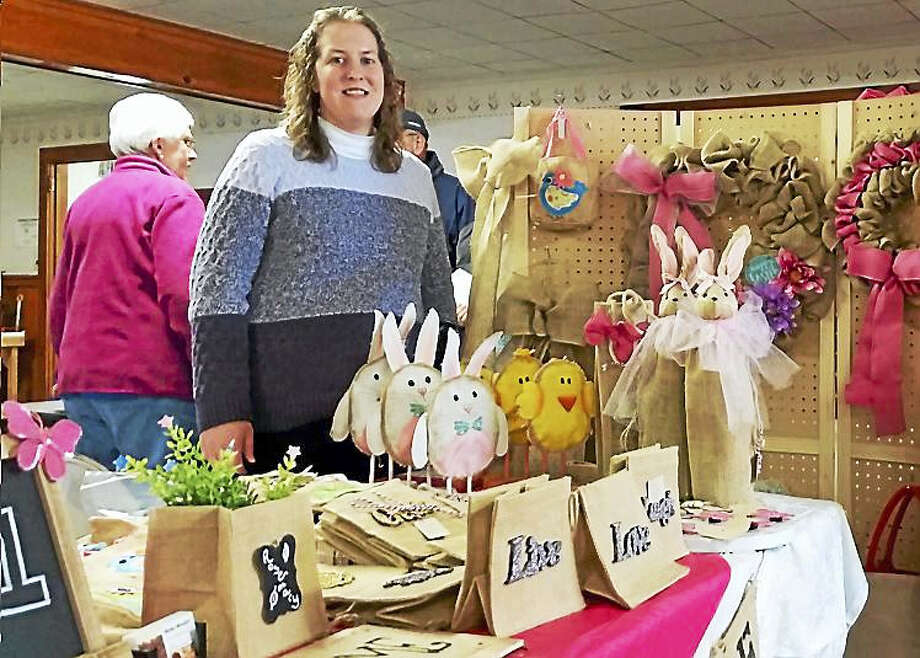 Karen Pavano of Burlap Beautiful showed off her homemade burlap bags, wreaths, and Easter-themed wine-bottle holders at the Winchester Grange's Cabin Fever Craft & Bake Sale this past weekend in Winchester. Photo: Photo By N.F. Ambery — The Register Citizen