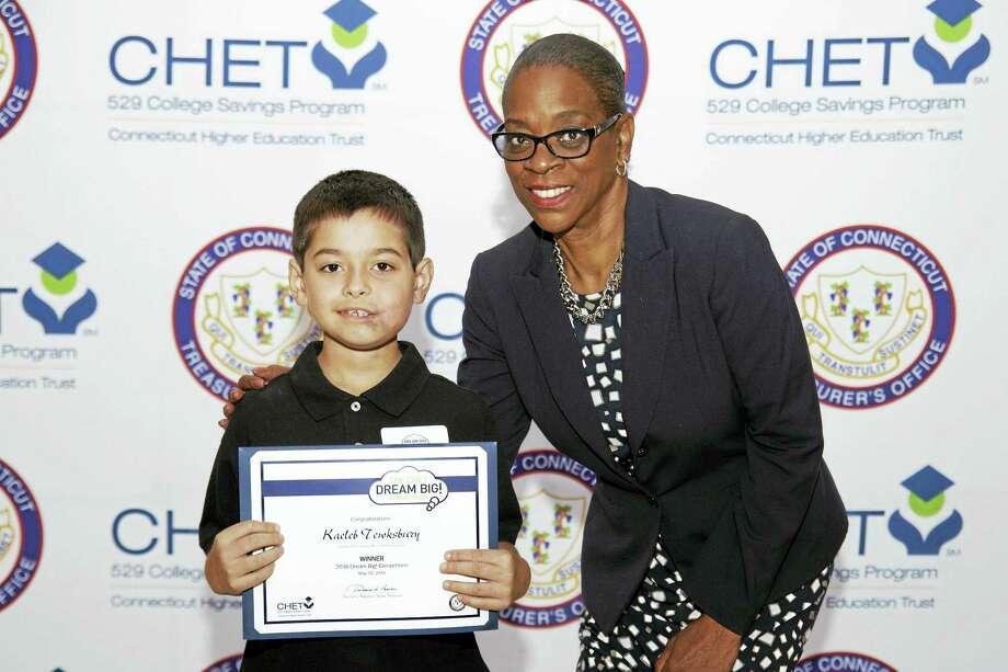 Contributed photoState Treasurer Denise L.Nappier presents an award to Kaeleb Tewksbury, Forbes Elementary School, Torrington. Photo: Journal Register Co.