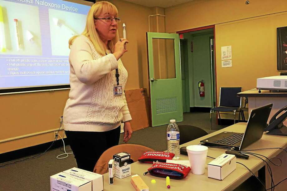 Susan Wolfe, a quality manager with the state Department of Mental Health and Addiction Services, holds a intranasal device used to dispense Narcan during a training session on Tuesday, Nov. 17, in Waterbury. Wolfe has trained more than 1,000 people on how to use the anti-overdose drug since 2012. Photo: ( Esteban L. Hernandez New Haven Register )