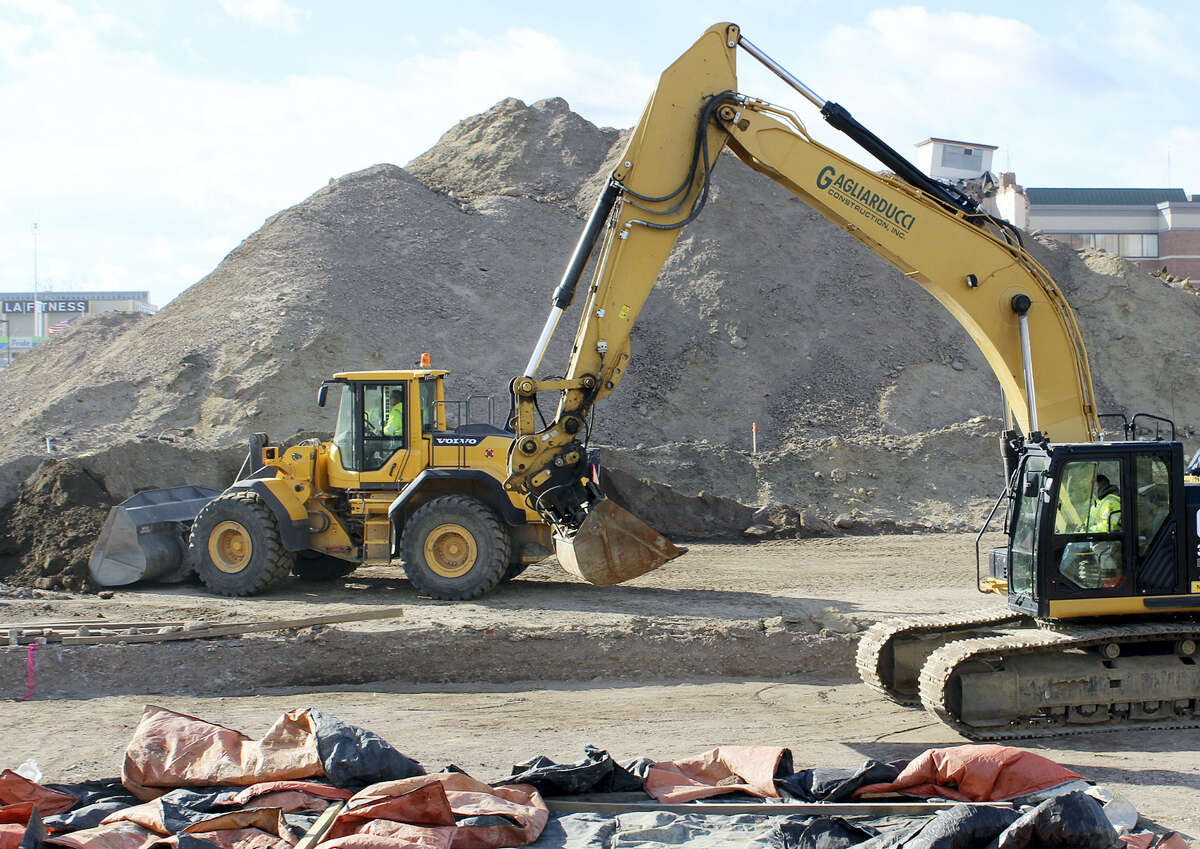 In this Jan. 19, 2016 photo, workers clear the site where a planned MGM casino is to be built in Springfield, Mass.