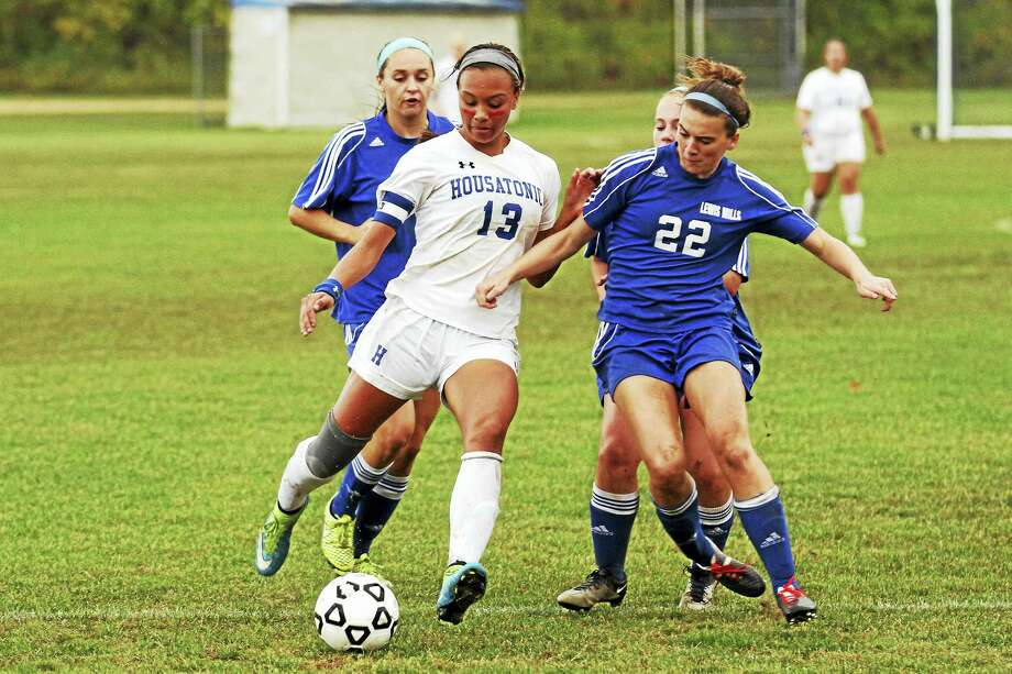 Photo by Marianne Killackey Housatonic's Lauren Segalla (13), the holder of the state's career goal record (120), draws a crowd of defenders wherever she goes, in this case led by Mills senior Maggie Hannon (22). Photo: Digital First Media / 2015