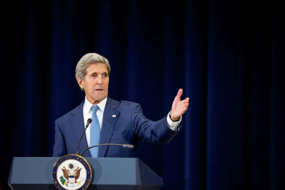 Secretary of State John Kerry speaks during a news conference at the State Department in Washington on Monday, July 27, 2015 where he released the 2015 Trafficking in Persons Report. The State Department has taken Malaysia and Cuba off its blacklist of countries failing to combat modern-day slavery, leaving the U.S. open to criticism that politics is swaying the often-contentious rankings in its annual human trafficking report. Photo: AP Photo/Andrew Harnik  / AP