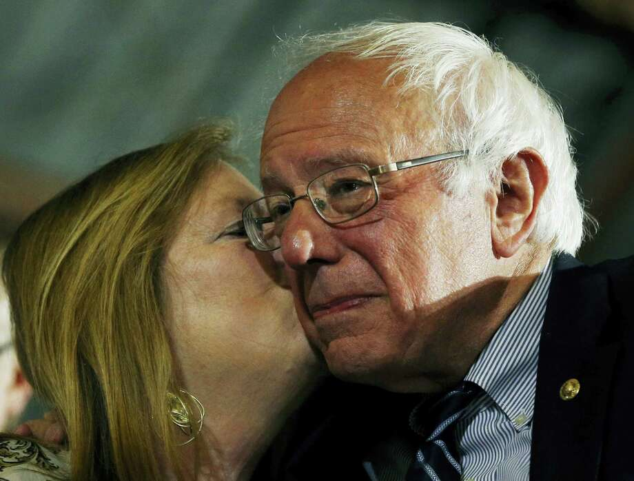 Democratic presidential candidate Sen. Bernie Sanders of Vermont gets a kiss from his wife, Jane O'Meara Sanders, at a rally Tuesday in Santa Monica, California. Photo: THE ASSOCIATED PRESS  / Copyright 2016 The Associated Press. All rights reserved. This material may not be published, broadcast, rewritten or redistribu