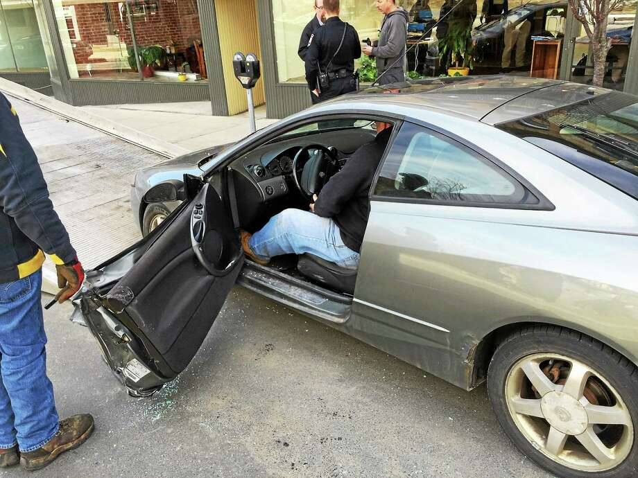 A local man was injured by a Coca-Cola branded tractor-trailer Tuesday morning on Water Street as he opened his car door into the truck's back tires as it passed by. Photo: Ben Lambert — The Register Citizen