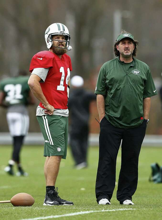 New York Jets quarterback Ryan Fitzpatrick talks with trainer John Mellody during Wednesday's practice. Photo: Rich Schultz — The Associated Press  / FR27227 AP