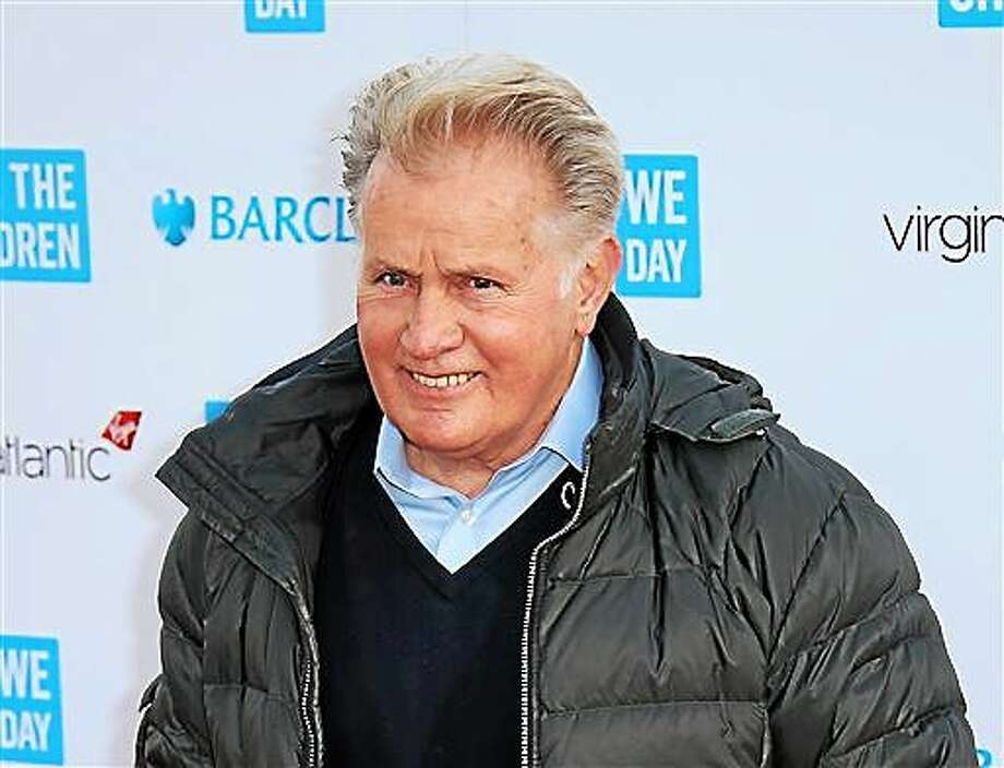 FILE - In this March 5, 2015 file photo, actor Martin Sheen poses for photographers on arrival at We Day UK at Wembley Arena, in west London. The University of Dayton will give actor Martin Sheen an honorary degree in recognition of his activism for peace, social justice and human rights. The school says the 74-year-old Sheen will receive an honorary doctor of humane letters degree at graduation ceremonies May 3 at the University of Dayton Arena. (Photo by Joel Ryan/Invision/AP, File) Photo: Joel Ryan/Invision/AP / Invision