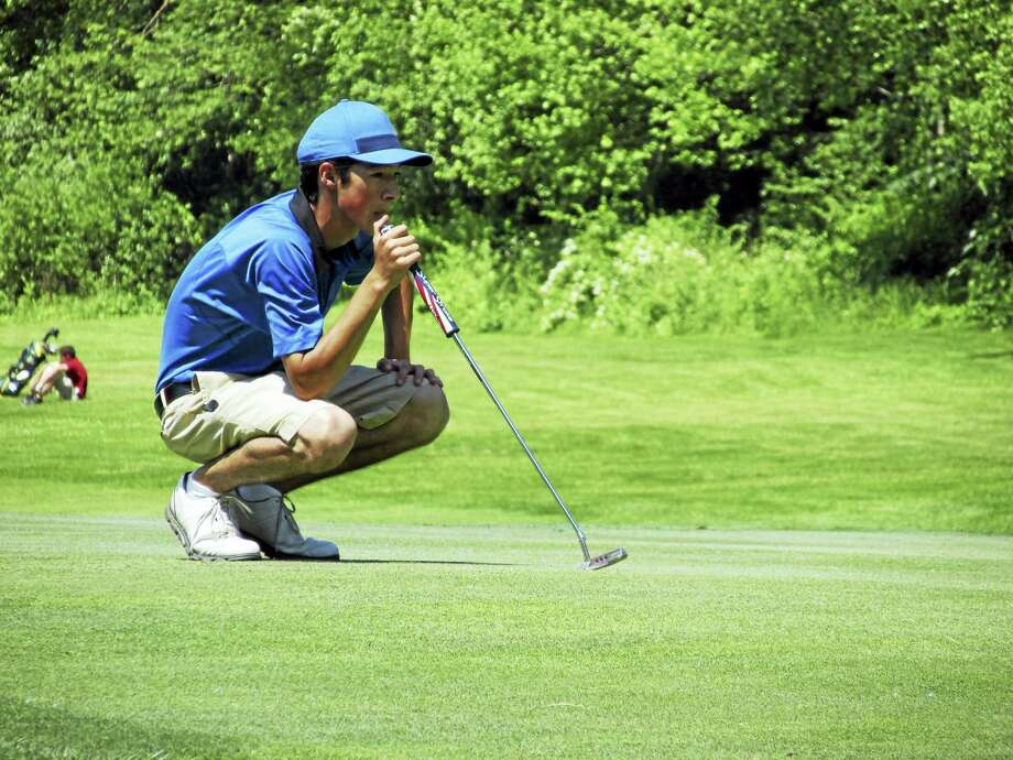 Lewis Mills' Tyler Goulet sizes up a putt at the CIAC Division III tournament at Watertown's Crestbrook Park Golf Course on Monday. Photo: Photo By Peter Wallace