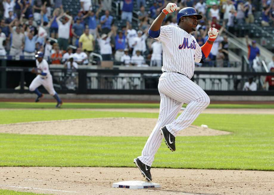 The Mets Juan Uribe celebrates after hitting walk-off single against the Dodgers in the 10th inning on Sunday. Photo: Kathy Willens — The Associated Press  / AP