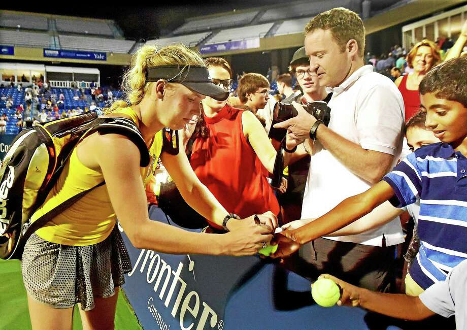 Caroline Wozniacki will be back in New Haven for the Connecticut Open this August. Photo: Catherine Avalone — New Haven Register  / Catherine Avalone/New Haven Register