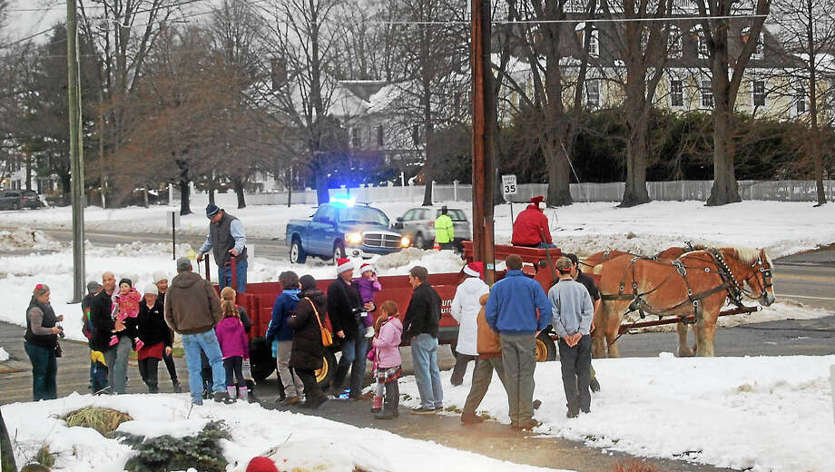 Participants in the 2014 Litchfield Holiday Stroll and Tree Lighting wait for a horse and buggy ride, courtesy of Bunnell Farm. Photo: Contributed Photo
