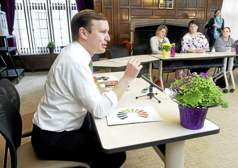 U.S. Sen. Chris Murphy, left, meets Monday with recovered addicts and staff at The Connection in New Haven during a state tour concerning opioid addiction. Photo: Arnold Gold — New Haven Register