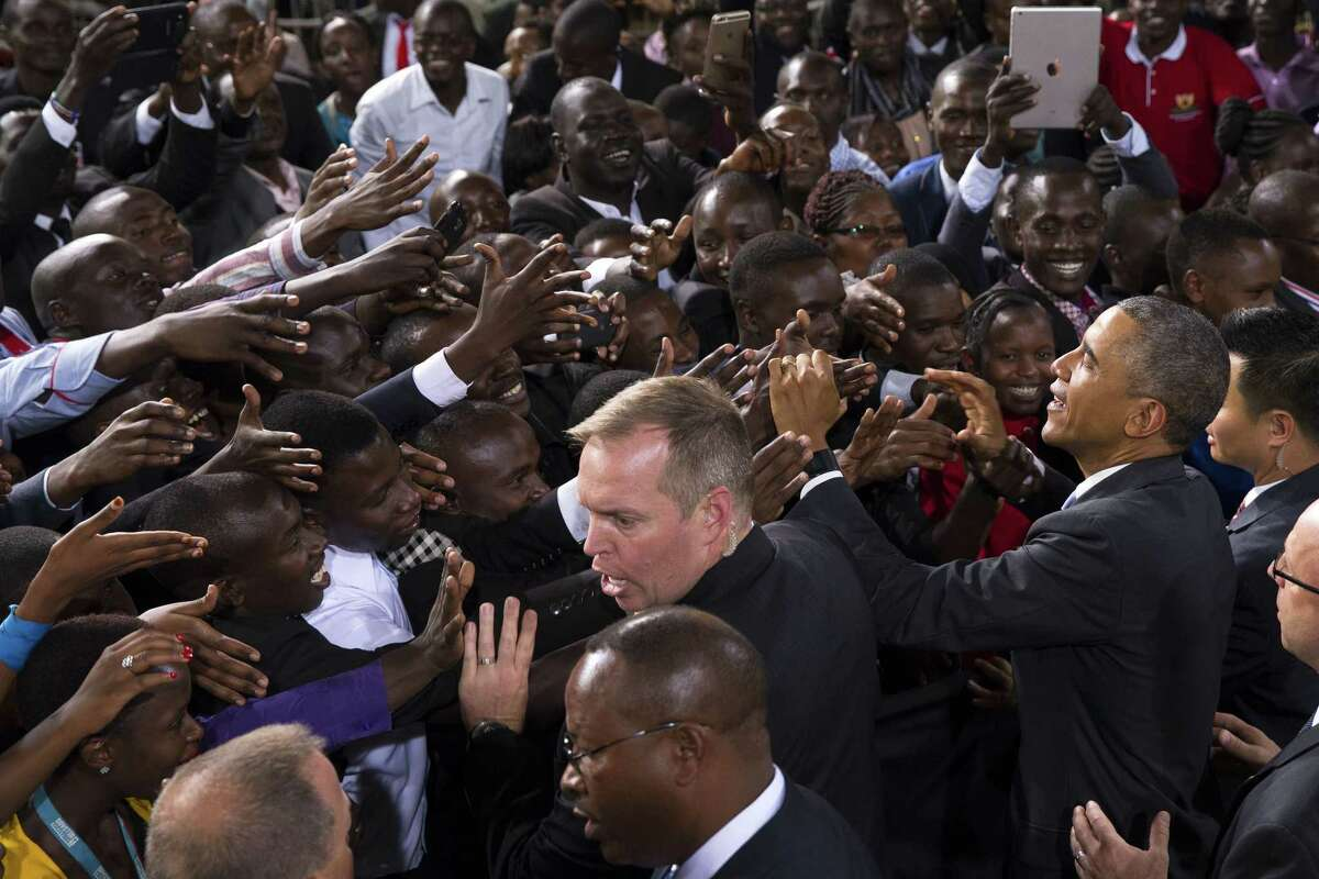 President Barack Obama, right, shakes hands after delivering a speech at Safaricom Indoor Arena, on July 26, 2015 in Nairobi. On the final day of his visit in Kenya, Obama laid out his vision for Kenya's future, and broad themes of U.S.-Kenya relations.