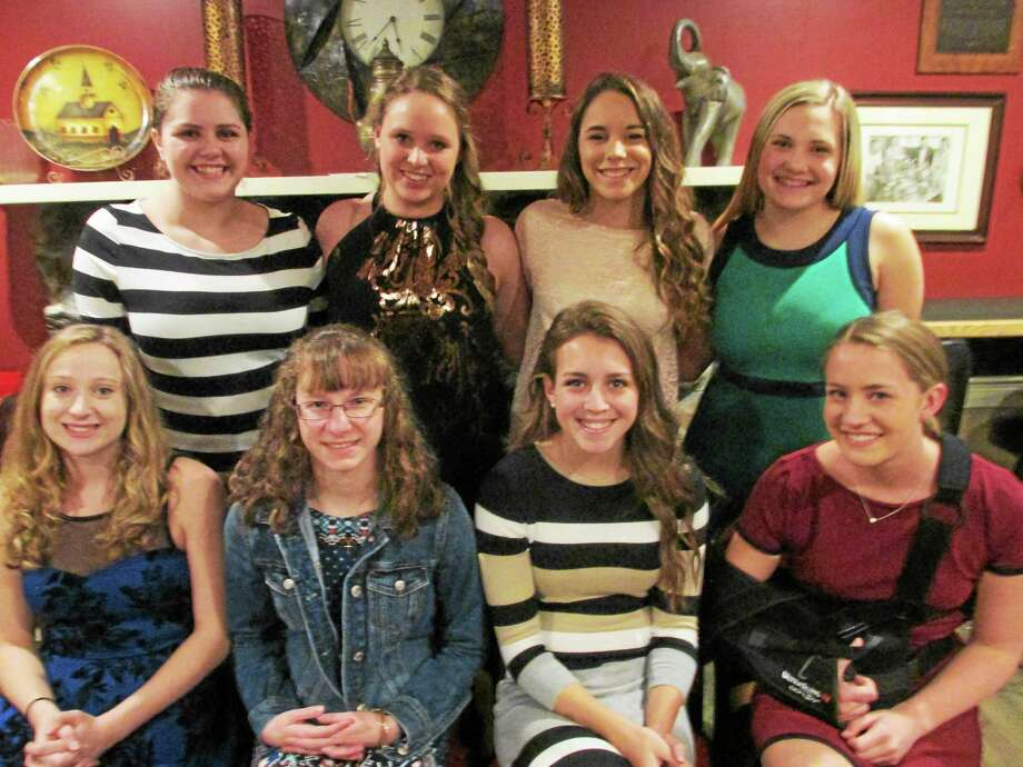 Torrington swimming and diving team seniors. Seated from left: Megan Sparks, Kaitlyn Richard, Jen Friscia, Cara McCarthy. Standing from left: Delilah Bourque, Jessica Gray, Sara Barry, Taylor Smart. Photo: Peter Wallace — Register Citizen