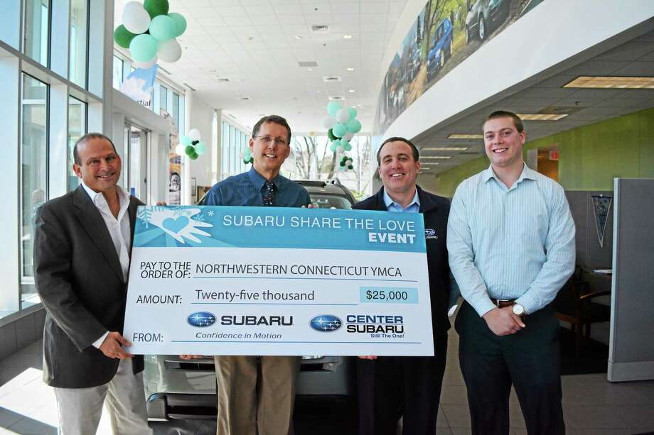 Representatives of Center Subaru presented a check for $25,000 to the Northwest CT YMCA Monday afternoon. Photo: Amanda Webster — The Register Citizen