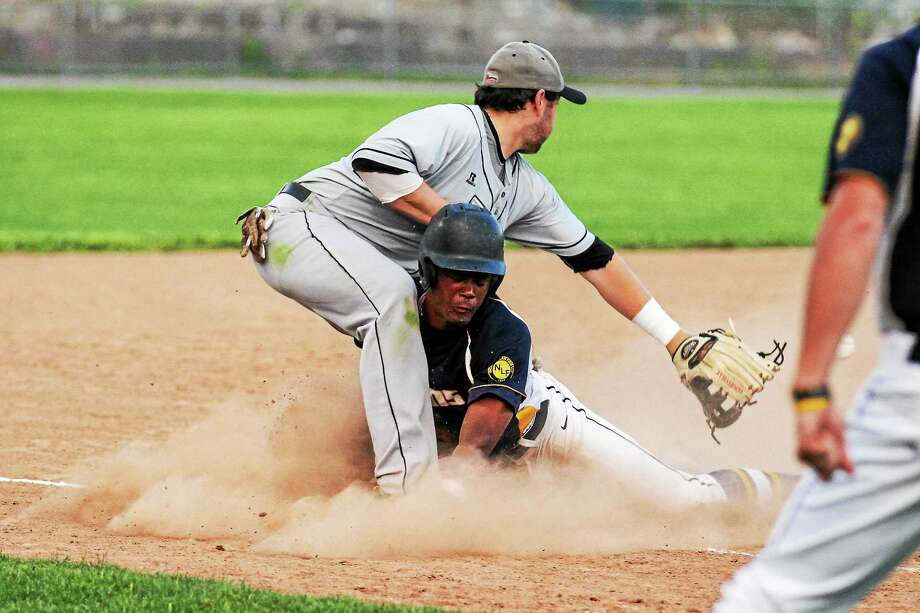 Marianne Killackey - For Register Citizen Franklin Jennings of the Titans is safe at third as Nashuaís Ryan Sullivan doesnít make the tag in time. Photo: Journal Register Co. / 2015