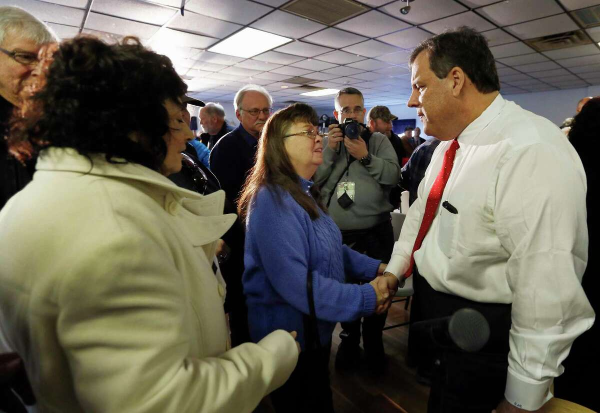 Republican presidential candidate, New Jersey Gov. Chris Christie shakes hands during a campaign stop, Tuesday, Feb. 2, 2016, in Epping, N.H.