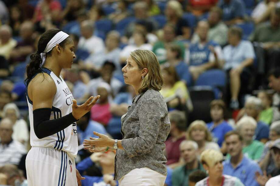Minnesota Lynx forward Maya Moore talks with head coach Cheryl Reeve during Wednesday's game against the Connecticut Sun in Minneapolis. Photo: Stacy Bengs — The Associated Press  / FR170489 AP