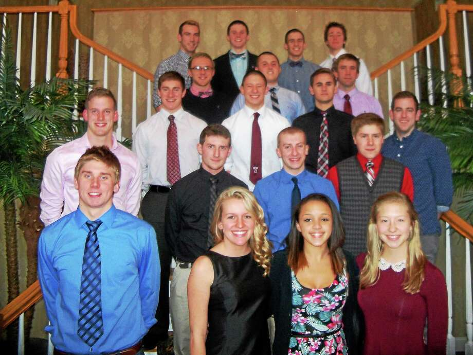 Torrington High School's swimming and diving team celebrated its season Sunday night at the Cornucopia Banquet Facility. Coaches and seniors are, first row, left to right: Coach Eric Traub, Emmy Fedor, Keisha Kittle, Emily Manchester. Second row: Coach Adam Stanley, Jon Fenwick, Jonah Heiland, Mitchell Canty. Third row: Alex Church, Nick Canino, Josh Rubino, Coach Rob Schapp. Fourth row: Jack Wasik, Kristian Eucalitto, Head coach Andrew Marchand. Fifth row: Josh Coscia, Matt Traub, Joe Canino, Aaron Pelletier. Photo: Peter Wallace — Register Citizen