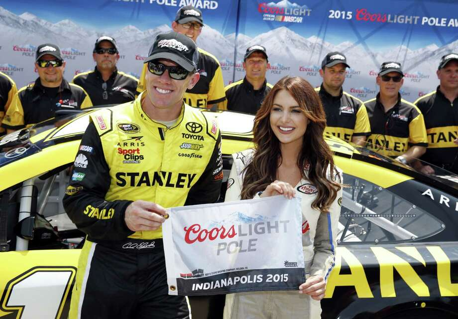 Carl Edwards poses Saturday after winning the pole during qualifying for the NASCAR Brickyard 400 at Indianapolis Motor Speedway in Indianapolis. Photo: AJ Mast — The Associated Press  / FR123854 AP