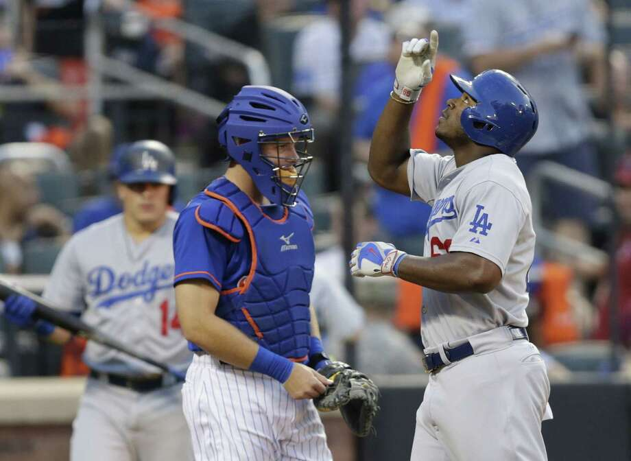 The Los Angeles Dodgers' Yasiel Puig gestures as he passes New York Mets catcher Kevin Plawecki after hitting a two-run home run on Friday night at Citi Field. Photo: Frank Franklin II — The Associated Press  / AP