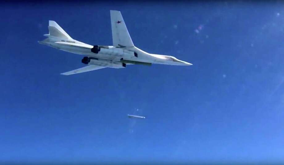 In this photo made from video released by Russian Defense Ministry official website on Friday, a Russian air force Tu-160 bomber launches a cruise missile on a target in Syria, according to information provided by Russian Defense Ministry. Photo: Russian Defense Ministry Press Service Via AP  / Russian Defense Ministry Press S