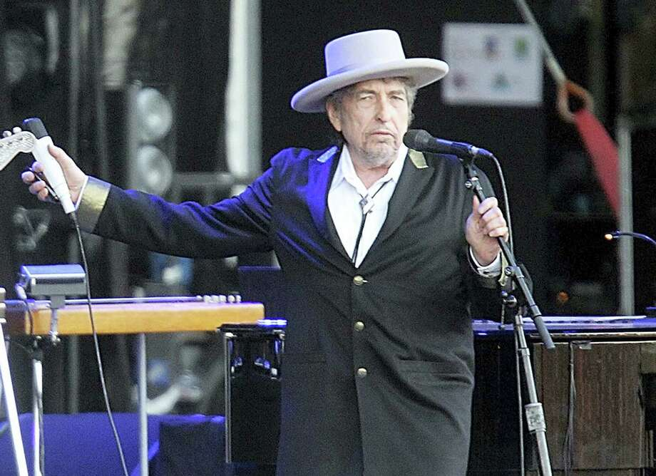 """This July 22, 2012 photo shows U.S. singer-songwriter Bob Dylan performing onstage at """"Les Vieilles Charrues"""" Festival in Carhaix, western France. Dylan won the 2016 Nobel Prize in literature, announced Thursday, Oct. 13, 2016. Photo: AP Photo/David Vincent, File  / Copyright 2016 The Associated Press. All rights reserved."""
