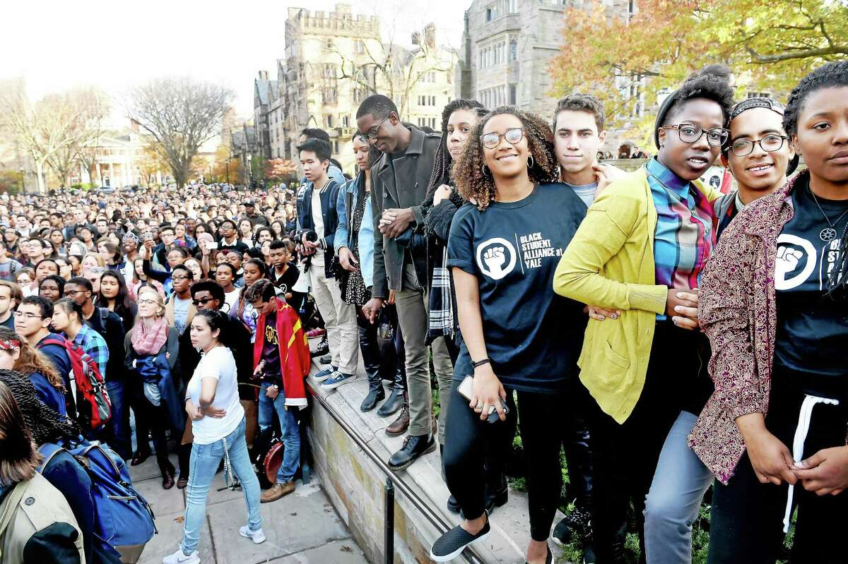 Members of the Black Student Alliance at Yale, right, and other Yale University students and faculty rally to demand that Yale University become more inclusive to all students on Cross Campus in New Haven on Nov. 9.