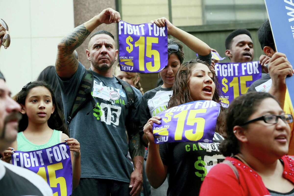 In this July 21, 2015 photo, workers hold a rally in Los Angeles in support of the Los Angeles County Board of Supervisors' proposed minimum wage ordinance. On March 26, 2016, California legislators and labor unions reached an agreement that will take the state's minimum wage from $10 to $15 an hour.