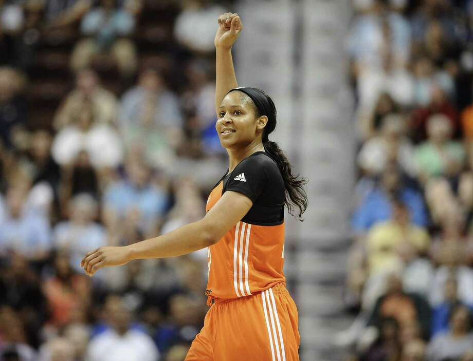 The Western Conference's Maya Moore, of the Minnesota Lynx, reacts in the final seconds of the WNBA All-Star Game on Saturday in Uncasville. The West won 117-112 and Moore, who scored 30 points, was named MVP. Photo: Jessica Hill — The Associated Press  / FR125654 AP