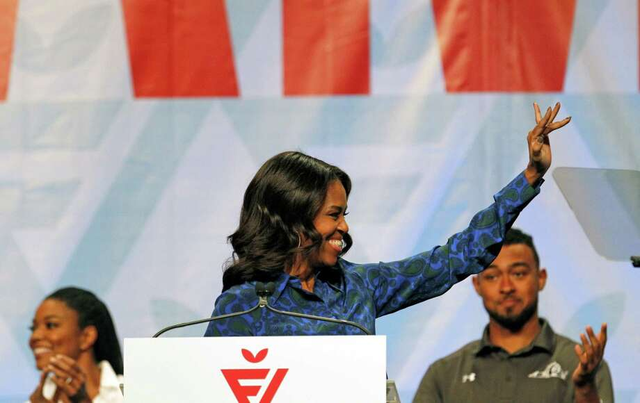 First lady Michelle Obama speaks at the FNV Live event in Norfolk, Va., Friday. Obama joined a host of celebrities and performers for the event, which was led by the Partnership for a Healthier America. Photo: AP Photo  / FR171388 AP