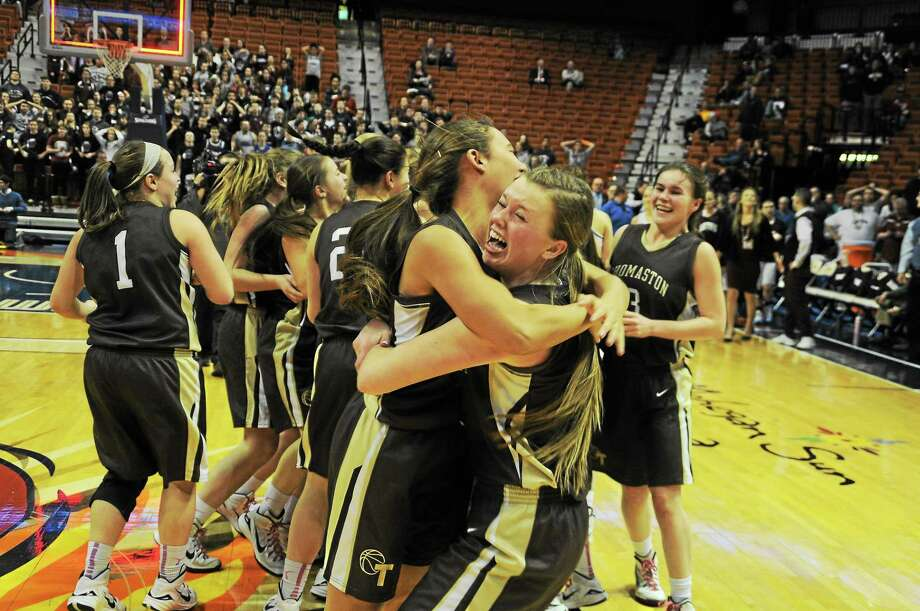 Sean Meenaghan / GameTimeCT.com The Thomaston girls basketball team celebrates it Class S state championship victory over Canton Saturday at Mohegan Sun. Photo: Journal Register Co.