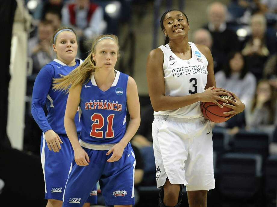 Morgan Tuck and UConn crushed Leah Fechko, back left, Katie Fox and St. Francis on Saturday night. Photo: Jessica Hill — The Associated Press  / AP2015