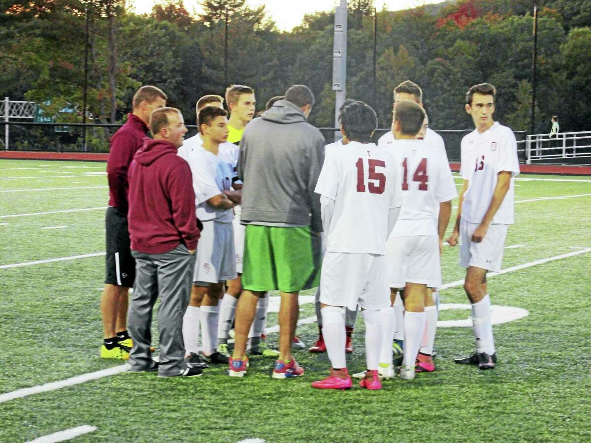 Torrington Coach Mike Fritch huddles his coaches and players before the Red Raiders beat Kennedy 4-0 at the Robert H. Frost Sports Complex Wednesday night.