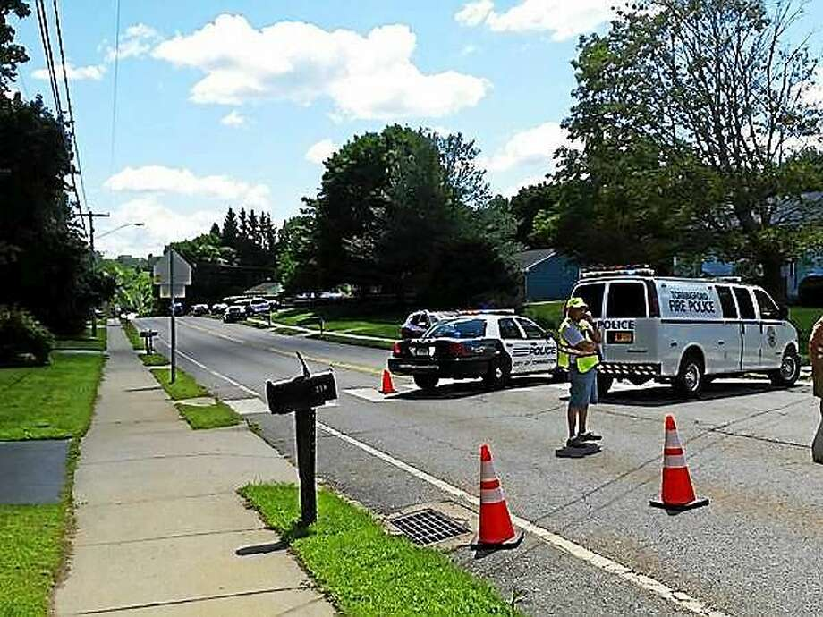 Torringford Street in Torrington was blocked off Friday afternoon as police tried to resolve a standoff situation in a local home. Photo: Amanda Webster — The Register Citizen