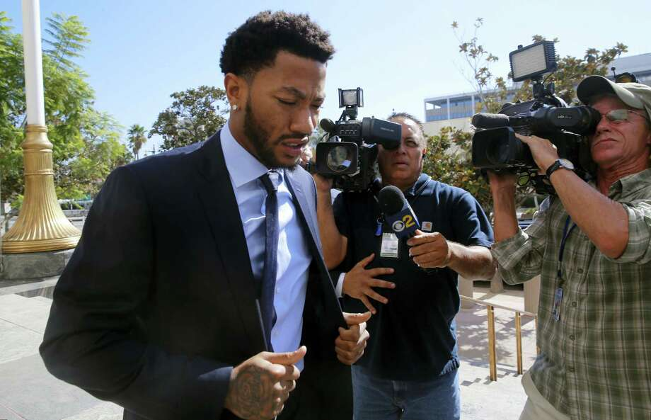New York Knicks player Derrick Rose arrives at U.S. District Court in downtown Los Angeles on Thursday. Rose's ex-girlfriend alleges the NBA star and two of his friends drugged and sexually assaulted her. Photo: Damian Dovarganes - The Associated Press   / Copyright 2016 The Associated Press. All rights reserved.