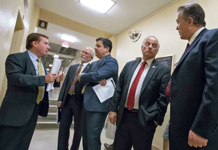 From left, House Foreign Affairs Committee Chairman Rep. Ed Royce, R-Calif., Rep. Dan Newhouse R-Wash., Rep. Raul Labrador, R-Idaho, Rep. Steve King, R-Iowa, and Rep. Trent Franks, R-Ariz., confer on Capitol Hill in Washington, Wednesday, Nov. 18, 2015, following a meeting of the conservative Republican Study Committee ahead of legislation aimed at increasing screenings for Syrian and Iraqi refugees before they enter the U.S., including a requirement for FBI background checks.   (AP Photo/J. Scott Applewhite) Photo: AP / AP