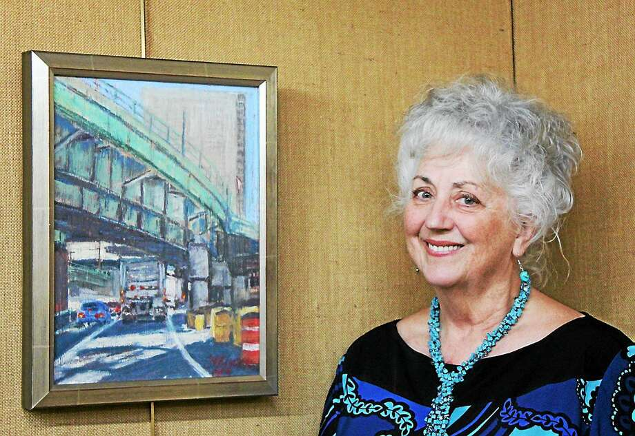 Carol Moore with her winning pastel ìG.W. Bridgeî  The Kent Art Association honored five of its members at last Saturdayís reception with Awards of Excellence. Co- Chair Connie Horton said that the Judges, sculptor Denis Curtiss of Kent, CT, Michael Spross, painter and educator from Millbrook, NY, and recognized wildlife painter Scott Zuckerman from Cornwall Bridge, CT, took three hours to make their choices among the 86 works in various media  submitted by its member artists. An exciting array of representational and non -representational works in oils, acrylics, watercolors, pastels, drawings and sculptures are on exhibit at the KAA Gallery through April 12th.  Awards of Excellence were presented to three artists working in oils: Dorothy Lorenze for, ìLight at Seven Hearthsî; Kate Hall for ìWhite Chrysanthemumsî and Zufar Bkbov for ìSentinals of Winter.î Keith Davidson received and award for his acrylic titled ìVincaî and Carol Moore for her Pastel, ìG.W,Bridge.î Mrs. Horton presented the awards to the winners at the Saturday reception, with refreshments provided by Board member Patsy Stroble. Photo: Journal Register Co.