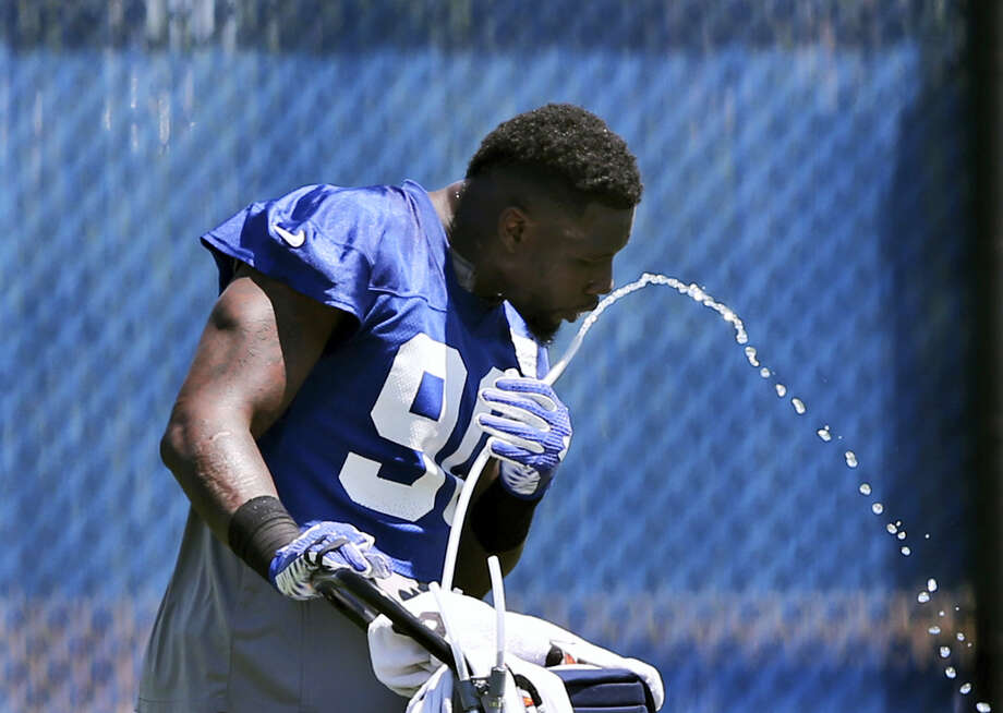 Defensive end Jason Pierre-Paul drinks water during practice at the Giants training facility on Monday. Photo: Mel Evans — The Associated Press  / Copyright 2016 The Associated Press. All rights reserved. This material may not be published, broadcast, rewritten or redistribu