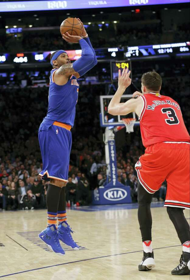 New York Knicks' Carmelo Anthony (7) shoots over Chicago Bulls' Doug McDermott (3) during the second half Thursday. The Knicks won 106-94. Photo: The Associated Press  / AP