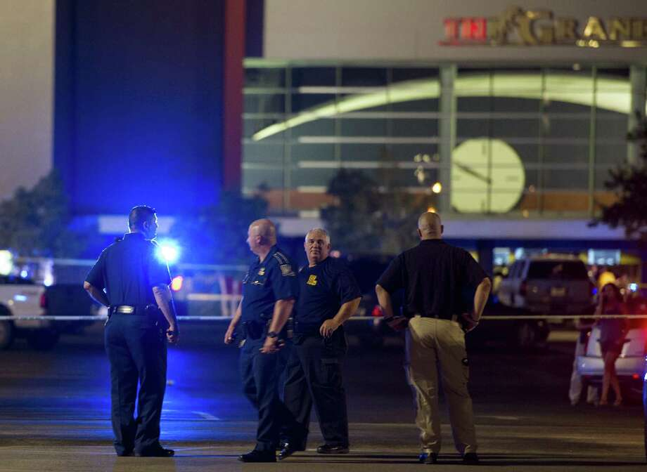 Law enforcement personnel stand near a police line at The Grand Theatre following a deadly shooting in Lafayette, La., Thursday. Photo: Paul Kieu/The Daily Advertiser Via AP / The Daily Advertiser