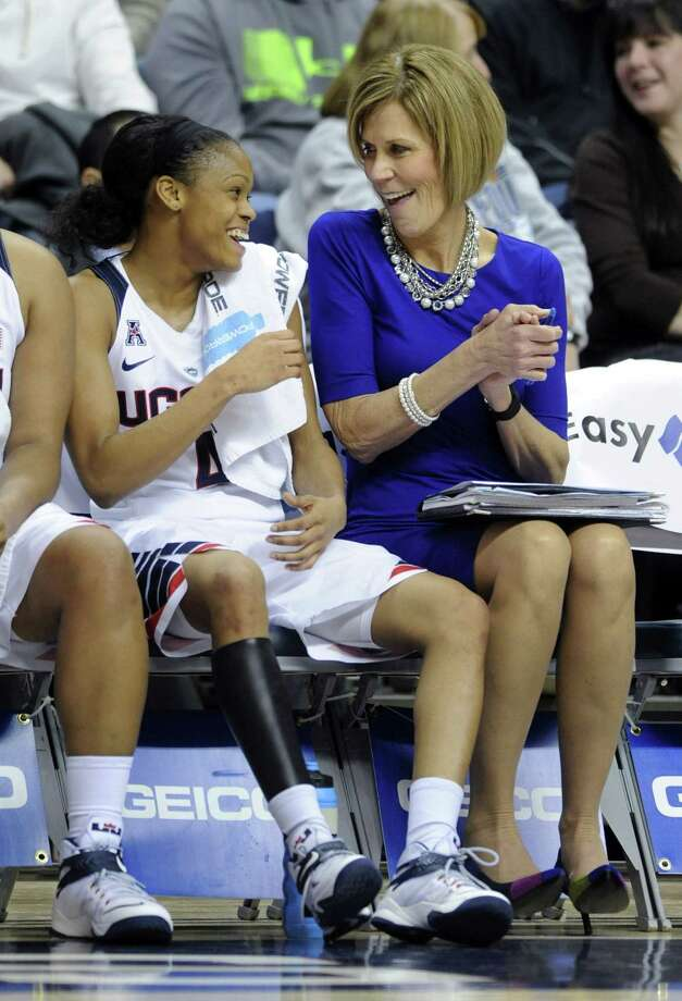UConn associate head coach Chris Dailey, right, and Moriah Jefferson share a smile during a game earlier this season. Photo: The Associated Press File Photo  / FR153656 AP