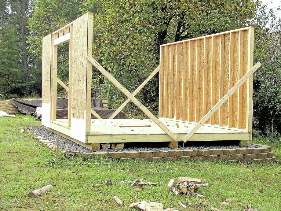 The sides of Larry Dolamore's shed, held in place with 2 x 4s. Photo: Journal Register Co.