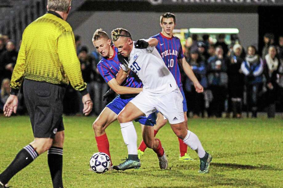 Frederick Marinelli of Lewis Mills and Michael Zimmerman of Tolland battle for control of the ball. Photo: MARIANNE KILLACKEY — REGISTER CITIZEN  / 2015