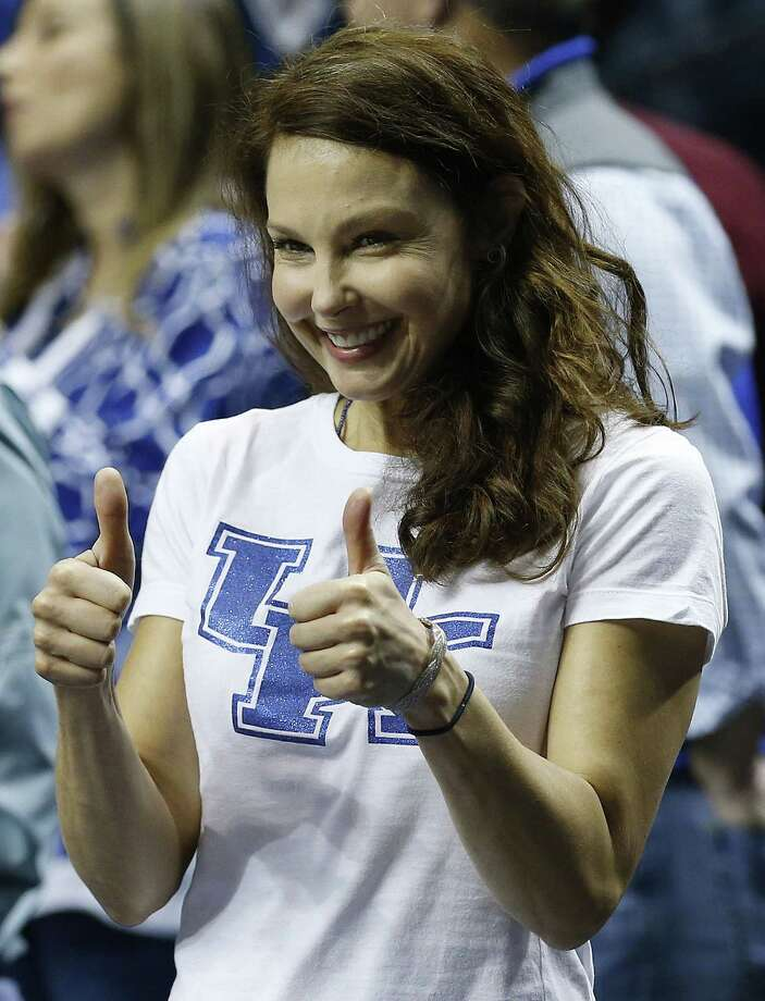 FILE - In this Sunday, March 15, 2015 file photo, actress Ashley Judd motions toward the Kentucky bench before the first half of the NCAA college basketball Southeastern Conference tournament championship game between Kentucky and Arkansas, in Nashville, Tenn. The Kentucky Wildcats fan Judd is firing back at those who posted threats and hateful comments online after she tweeted that she thought Arkansas was playing dirty in its SEC basketball matchup with her alma mater. In an online essay posted Thursday, March 19, 2015, on mic.com, Judd says she routinely copes with tweets that ìsexualize, objectify, insult, degrade and even physically threaten me.î  (AP Photo/Steve Helber, File) Photo: AP / AP