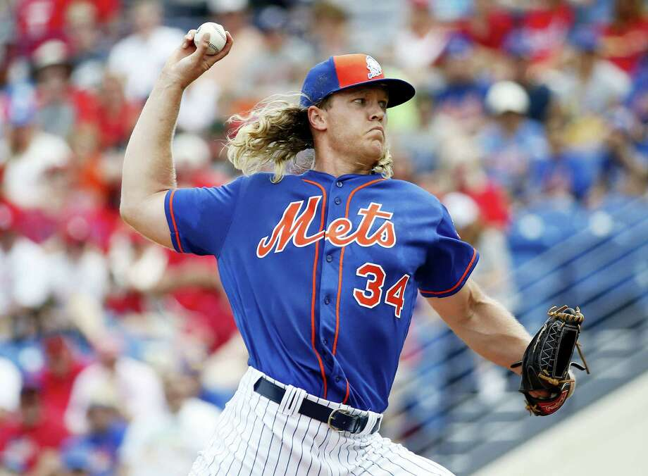 Mets starting pitcher Noah Syndergaard throws during the first inning of a spring training game against the Cardinals on Friday. Photo: Brynn Anderson — The Associated Press  / Copyright 2016 The Associated Press. All rights reserved. This material may not be published, broadcast, rewritten or redistributed without permission.
