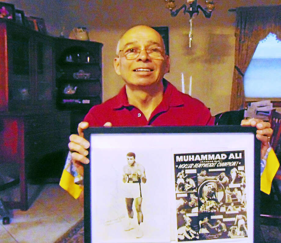 Michael Guarnieri of North Haven got a moment with Muhammad Al, when the champion boxer visited New Haven with his bride in 1967 Photo: Contributed / Copyright 2009