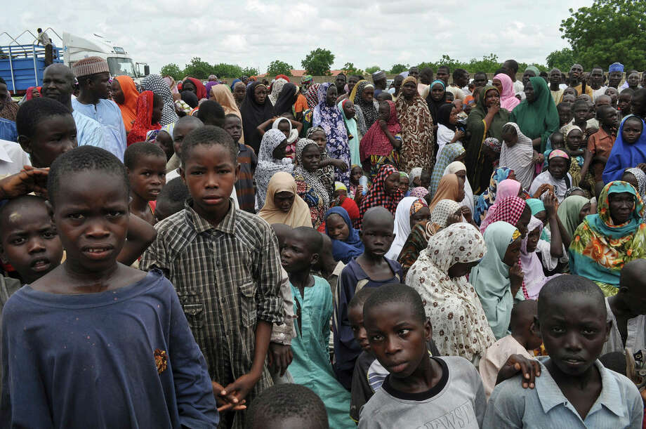 In this Sept. 9, 2014 photo, civilians who fled their homes following an attack by Islamist militants in Bama, take refuge at a school in Maiduguri, Nigeria. Photo: AP Photo/Jossy Ola, File  / AP
