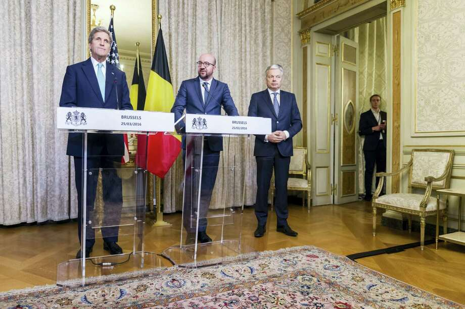 Belgium's Prime Minister Charles Michel, center, Foreign Minister Didier Reynders, right, and U.S. Secretary of State John Kerry address the media after a meeting at the Prime Minister's residence in Brussels, Belgium, Friday, March 25, 2016. Kerry is holding counterterrorism talks in Brussels on Friday as top members of Belgium's embattled government face ongoing criticism for a series of security and intelligence failings in the run-up to this week's bomb attacks in the city that killed over 30 people and wounded hundreds. Photo: AP Photo — Geert Vanden Wijngaert / AP